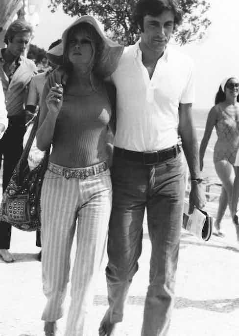 The French actress and model Brigitte Bardot walking with the Italian actor and playboy Gigi Rizzi. Saint-Tropez, August 1968 (Photo by Mondadori Portfolio via Getty Images)