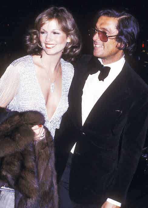 Phyllis George and Evans in 1977 (Photo courtesy of Getty)