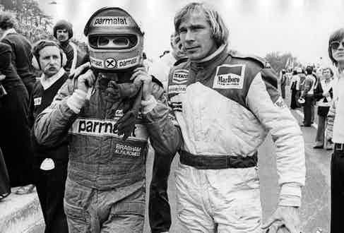 British racing driver James Hunt (1947 - 1993) and Austrian Niki Lauda abandoning the race after they have crashed into each other. (Photo by Hulton Archive/Getty Images)