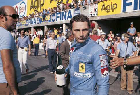 Austrian car racing driver Niki Lauda holding a bottle of water before taking part in the Italian Grand Prix. Monza, 8th September 1974  (Photo by Sergio del GrandeMondadori via Getty Images)