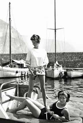 Marella Agnelli and Princess Pignatelli in the port of Beaulieu-sur-Mer, 1962 (Photo by Henry Clarke/Condé Nast via Getty Images)