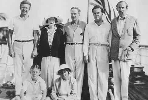The Vanderbilt family return to Miami Beach, Florida from a cruise on the yacht 'Alva' circa 1930. Left to right are Robert Lancaster, Rosamund Warburton Vanderbilt, Commodore Vanderbilt, William K. Vanderbilt II and Pierre Merillon. In front are children Barclay H. Warburton III and Rosemary Warburton. (Photo by FPG/Getty Images)