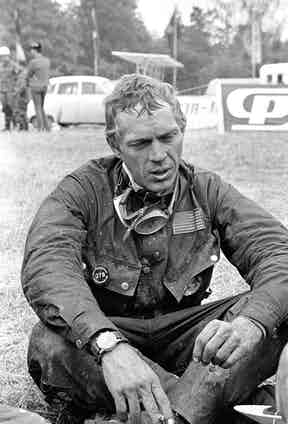 Steve McQueen after his run out on the 1964 IDST track. Each evening after the race (300km on average, on terrible paths), the paths, the runners used to collapse on the grass, covered in mud and oil. On his wrist is visible is the Hanhart 417 ES (Photo by Garcon Gragnon / Paris Match via Getty Images)