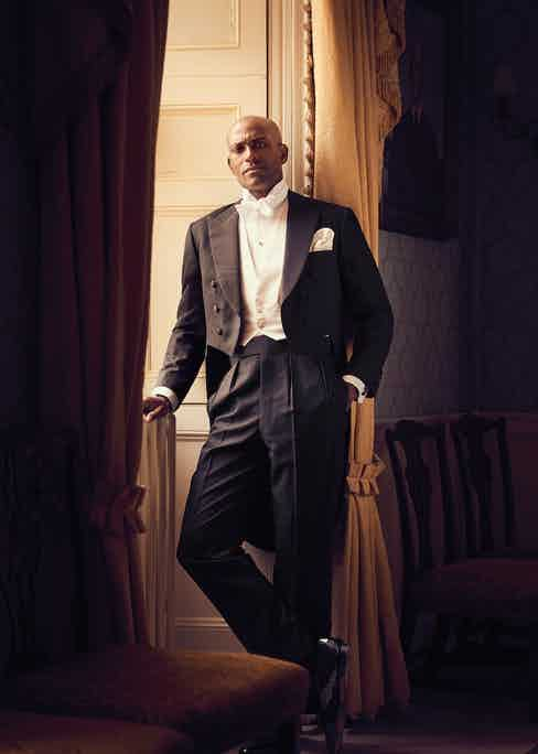 Black feather weave tailcoat and black wool brace trousers with double-braid side seams, white Marcella waistcoat with four white pearl buttons and white stiff bib shirt front and cuff with detachable wing collar and white Marcella bow-tie, all by Henry Poole & Co; patent leather black tie pumps, George Cleverley; Rhodium and Onyx dress set, Codis Maya at TheRake.com; pocket- watch, property of The Rake.