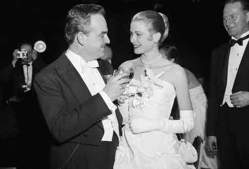 """Grace Kelly and her fiance Prince Rainier III of Monaco, toast each other during """"Imperial Ball"""" at the Waldorf-Astoria  (Image by © Bettmann/CORBIS)"""