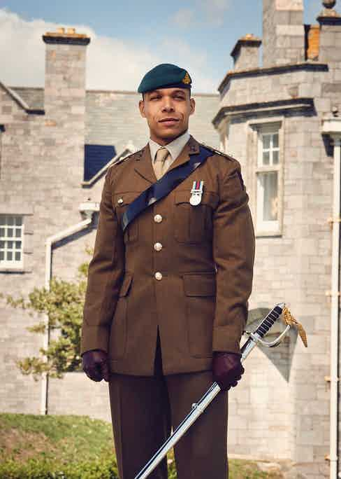 Royal Artillery officer's service dress (aka Number 2s) plus green commando beret and officer's cloth cap badge of the Royal Artillery. The sword is Kidane's Sandhurst Sword of Honour; inscription visible opposite.
