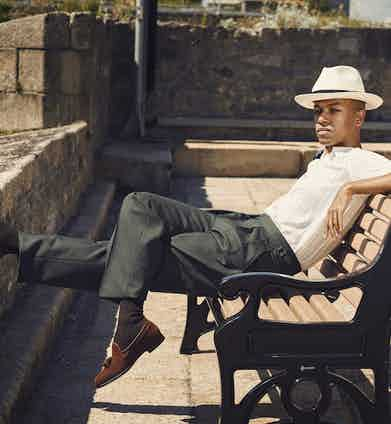 Cream Japanese Serie knit shirt, Yuri & Yuri at The Rake; green tropical wool Aleksandar trousers, Kit Blake at The Rake; brown cotton socks, The London Sock Co; wide rim Panama hat, Lock & Co; tan Polo suede Gabriel tassel loafer, George Cleverley.