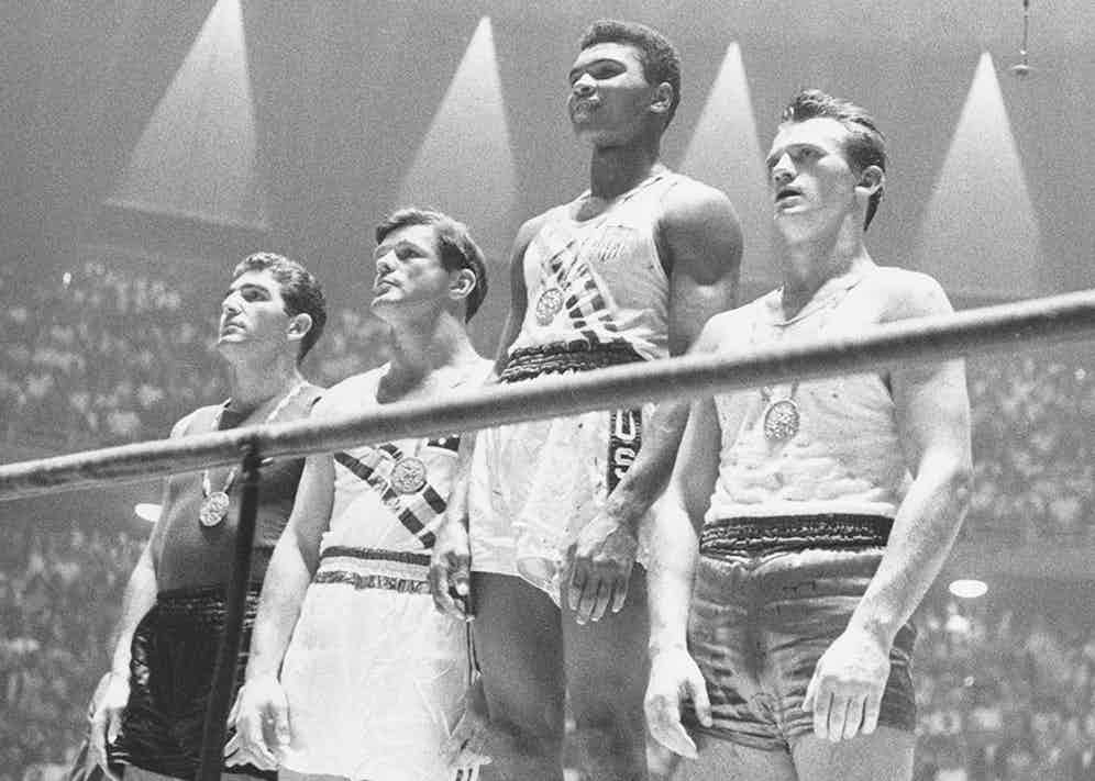 Collecting his gold medal at the 1960 Olympics in Rome (Photo courtesy of Getty Images)