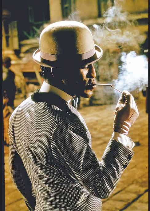 Lighting a cigarette in Porgy and Bess, 1959.  (Photo by Gjon Mili/The LIFE Picture Collection via Getty Images)
