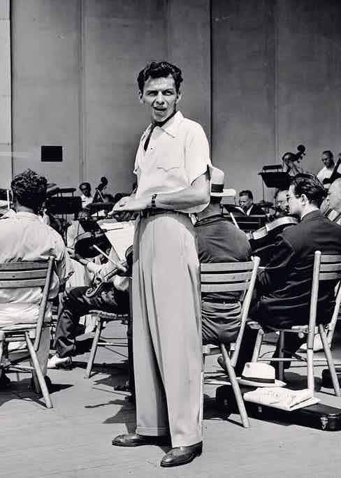 Sinatra during a soundcheck, with Max Steiner conducting the orchestra at Lewisohn Stadium in New York, 1943 (Photo by George Karger/Pix Inc./The LIFE Images Collection via Getty Images/Getty Images)