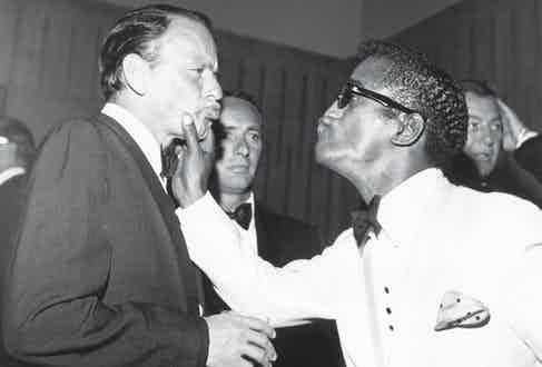 With Frank Sinatra at a charity dinner in July 1961