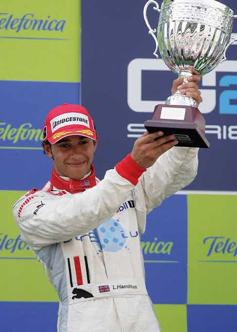 On the podium after the GP2 race at the Circuit de Catalunya, 2006. (Photo by Mark Thompson/Getty Images)
