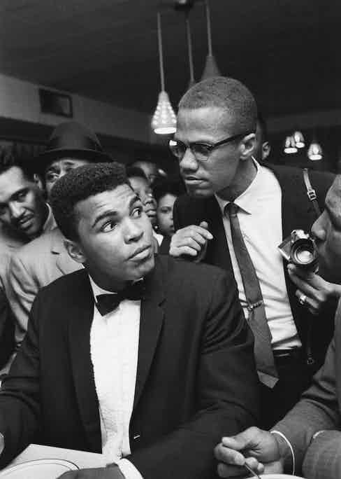 Malcolm X and Ali, then Cassius Clay, after Ali beat Sonny Liston in Miami, 1964 (Photo courtesy of Getty Images)