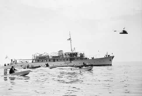 Some of the scores of small craft that surrounded Prince Rainier's yacht to welcome actress Grace Kelly are shown bobbing on the choppy waters of Monaco Bay shortly after the princess-to-be was escorted aboard by Prince Rainier.  (Image by © Bettmann/CORBIS)