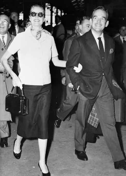 Prince Rainier of Monaco and Princess Grace walk arm in arm at the railroad station in Paris on their arrival from Monaco., September 4, 1956 (Image by © Bettmann/CORBIS)
