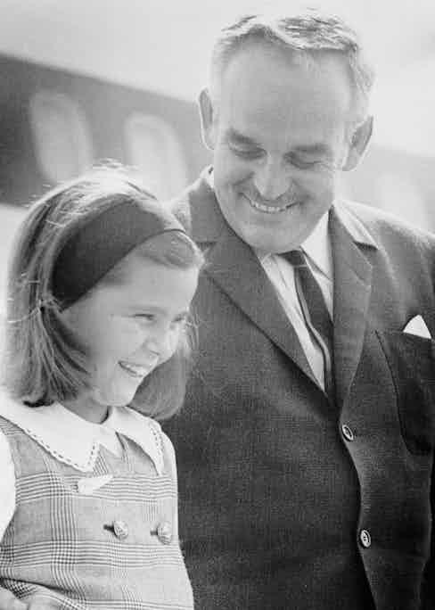 Prince Rainier III of Monaco and his daughter, Caroline, 9, flash two royal smiles at Logan Airport  (Image by © Bettmann/CORBIS)