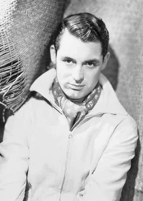 Cary Grant wearing a jacket and cravat, 1933 (Photo by Otto Dyar/John Kobal Foundation/Getty Images)