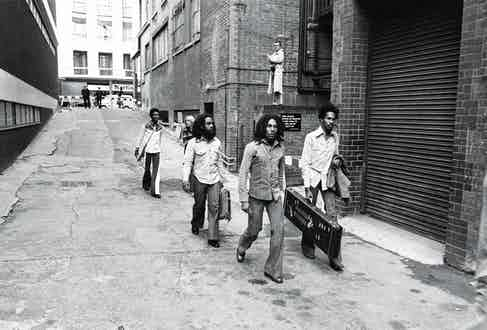 Walking with the Wailers down an alley behind the Odeon in Birmingham, 1975. Photo by Ian Dickson/Shutterstock (750578os)
