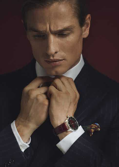 Code 11.59 by Audemars Piguet Selfwinding 18-carat white-gold case. Smoked lacquered burgundy dial with sunray pattern base.Navy wool chalkstripe jacket, New & Lingwood; white cotton shirt,Emma Willis; burgundy silk tie with yellow and blue pattern, E. Marinella at The Rake; yellow multicolour silk pocket-square, Fumagalli 1891 at The Rake.