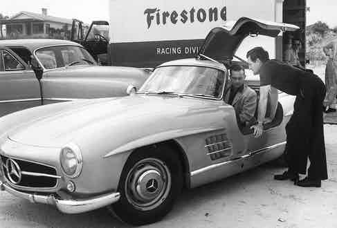 """Racing drivers Phil Hill and Briggs Cunningham check out a new """"gull wing"""" Mercedes 300 SL, 1955. Photo by ISC Images & Archives via Getty Images."""