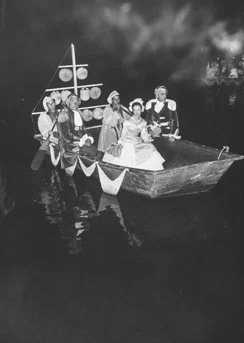 Dressed up on a boat (far left)during a ball for cancer research at the Palace of Versailles. (Photo courtesy of Getty Images)