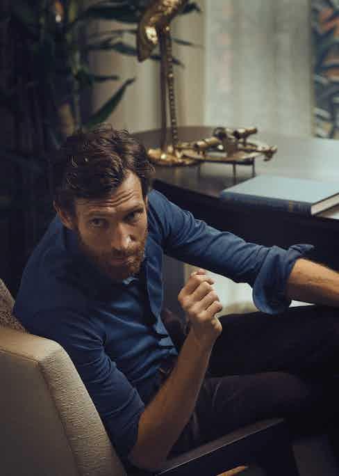 Petrol pique long sleeve polo shirt, Eton; Brown corduroy trouser, New & Lingwood.