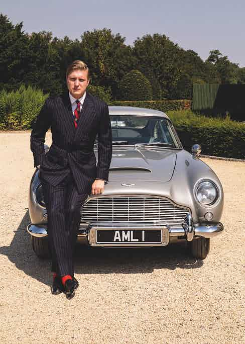 The Rake's Editor, Tom Chamberlin, having driven the car to Stoke Park, where 007 played golf against the Bond film's antagonist and eponym, Goldfinge