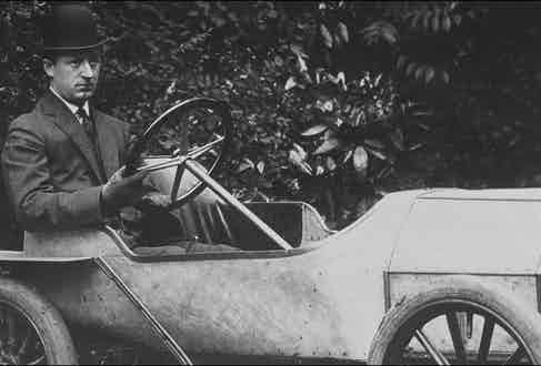 Bugatti at the wheel of one of his cars. Photo by Raphael GAILLARDE/Gamma-Rapho via Getty Images.
