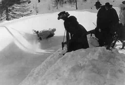 Spectators watching an English woman on the Cresta Run, St. Moritz, Switzerland. (Photo by Hulton Archive/Getty Images)