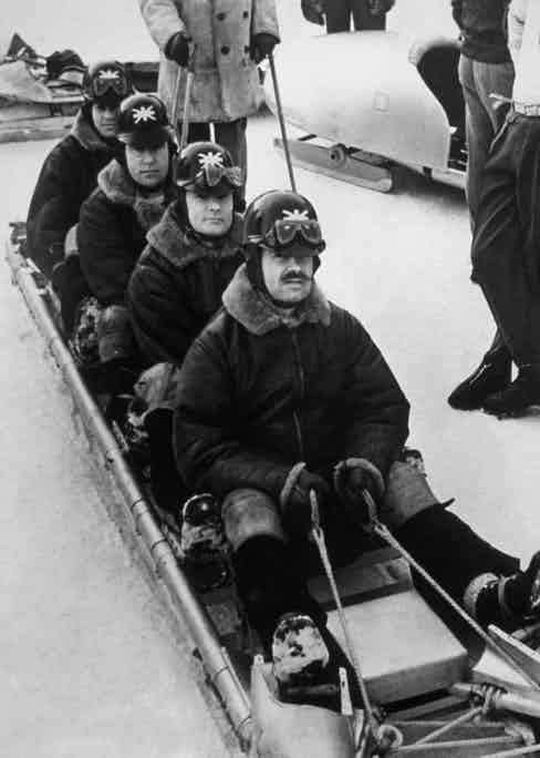 Britain's bobsleigh team prepare for the Cresta Run during their training at the 1948 St. Moritz Winter Olympics. (Photo by Keystone/Getty Images)