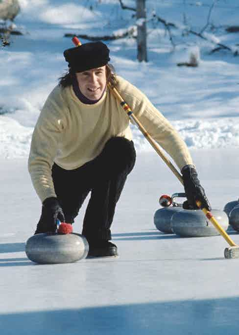 Jackie Stewart curling Photo by Rolls Press/Popperfoto via Getty Images/Getty Images)