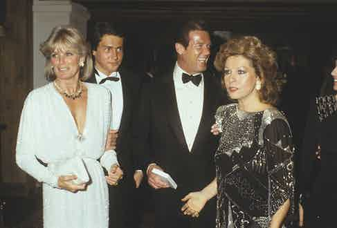 Linda Evans, Roger Moore and Luisa Moore (Photo by Bertrand LAFORET/Gamma-Rapho via Getty Images)