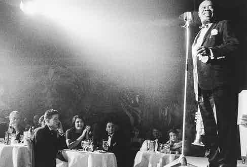 Louis Armstrong performs at the palace