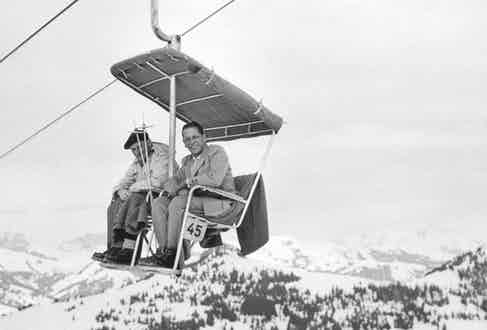 Field Marshal Montgomery on a wooden ski lift wearing his famous wartime beret