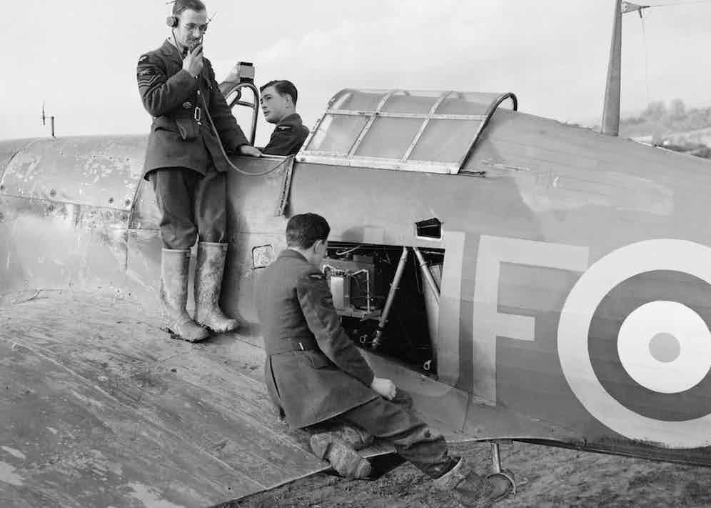 Radio mechanics test the transmitter in a 601 Squadron Hawker Hurricane (Photo via Getty)