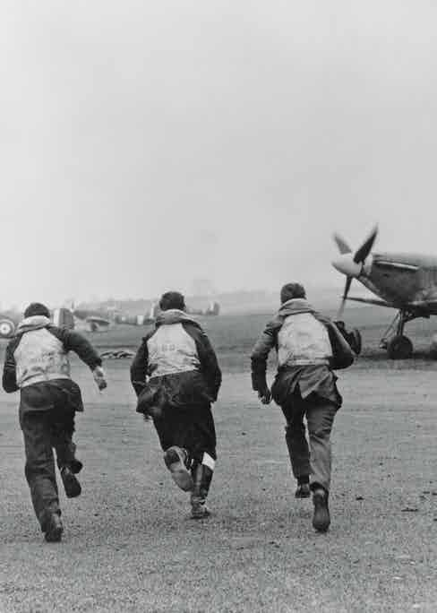 Pilots of No. 601 Squadron scramble for their Hawker Hurricane fighters at RAF Northolt in December 1940. (Photo via Getty)