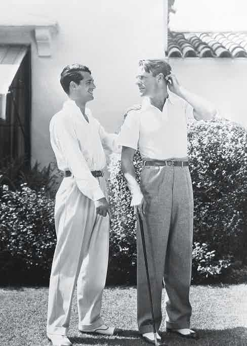 British born actor Cary Grant (1904 - 1986), born Archibald Leach, with the American actor, Randolph Scott (1898 - 1987). The two stars shared a beach house during the 1930's, which was jokingly known as Bachelor Hall. (Photo via John Kobal Foundation/Getty Images)