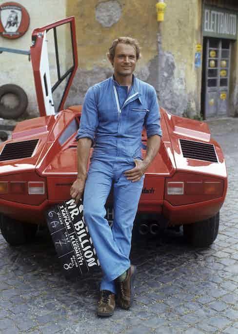 Leaning on a Lamborghini on the set of Mr. Billion, 1976 (Photo by Rino PetrosinoMondadori via Getty Images)