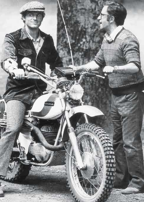 The late Italian director Marcello Fondato showing Hill how to drive an Ossa motorbike on the set of Watch Out, We're Mad! in Rome in 1974 (Photo by Rino PetrosinoMondadori via Getty Images)