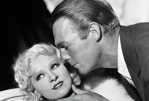 Randolph Scott caresses Mae West's chin in Go West Young Man, 1936