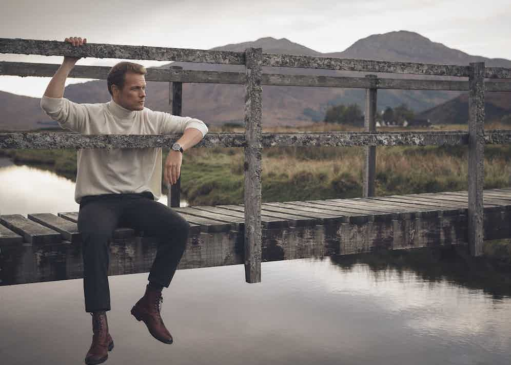Cream cashmere roll-neck, New & Lingwood; Shetland brown Donegal trousers, Walker Slater at The Rake; Damson Utah 'Galway' boots, Edward Green at The Rake; Scottish Lisle cotton socks, The London Sock Company at The Rake; Code 11.59 by Audemars Piguet Selfwinding Chronograph,18-carat white-gold case, lacquered black dial and counters. Black alligator strap with white-gold buckle.