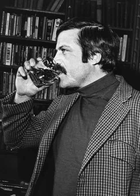 Oliver Reed drinking a half pint of beer (Photo by Chris Ware/Keystone Features/Getty Images)