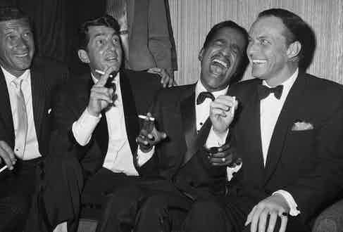 Jan Murray (L) sits alongside Rat Pack members Dean Martin, Sammy Davis Jr., and Frank Sinatra as the group unwinds backstage at Carnegie Hall after entertaining at a benefit performance in honor of Dr. Martin Luther King Jr, New York, 1961 (Image by © Bettmann/CORBIS)