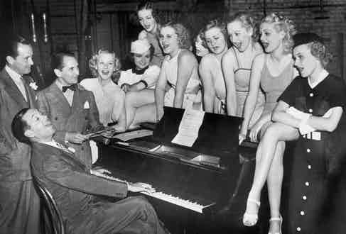 A group of singers join Porter in rehearsal for Wait for Baby in New York, 1936 (Image by © Bettmann/CORBIS)