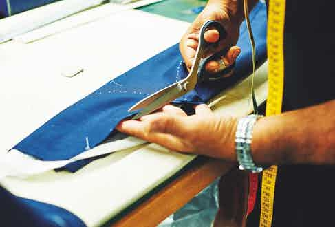 A demonstration of the different handcrafted techniques that go into a bespoke suit: cutting
