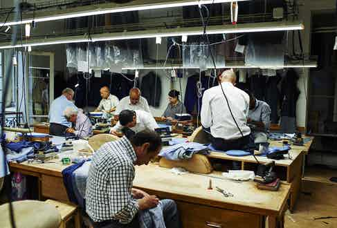 A demonstration of the different handcrafted techniques that go into a bespoke suit: of course lots of teamwork