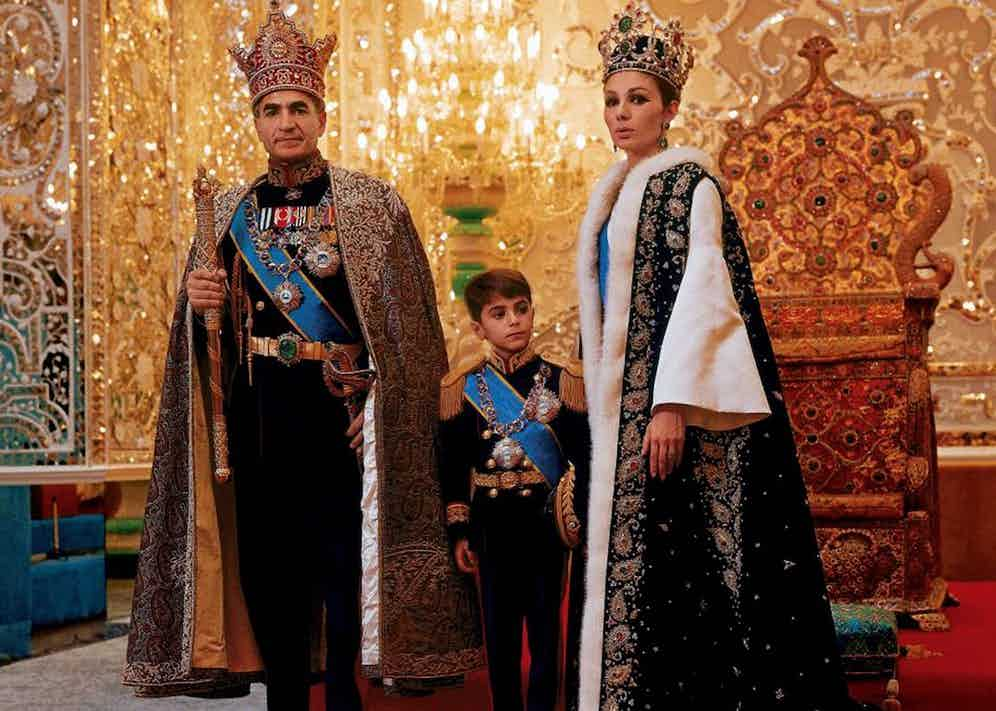 With Farah and their son Reza in ceremonial dress in front of the throne, circa early 1970s (Photo by Universal History Archive/Getty Images)