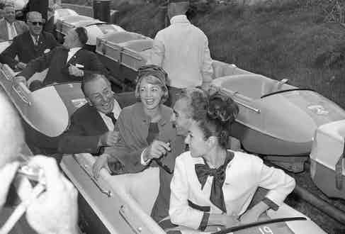 The Shah and Empress Farah hosted by Walt Disney at Disneyland, 1962 (Photo via Getty)