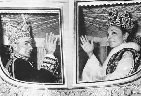 Waving with Farah from their carriage following their coronation ceremony in 1967 (Photo via Getty)