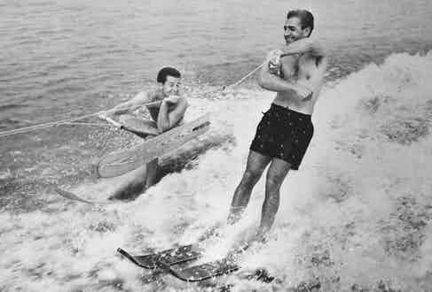 On holiday with former world waterskiing champion Dick Pope Jr, 1955 (Photo via Getty)